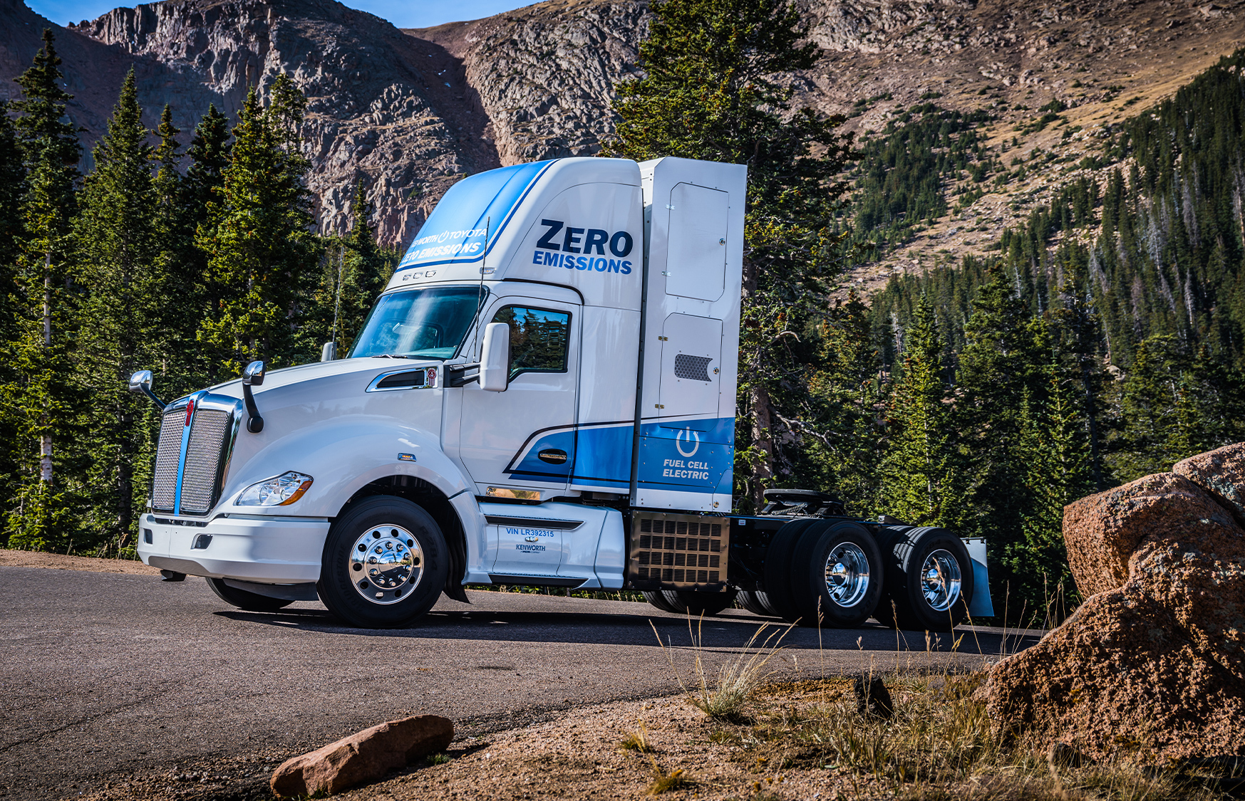 Kenworth T680 electric parked in front of mountain